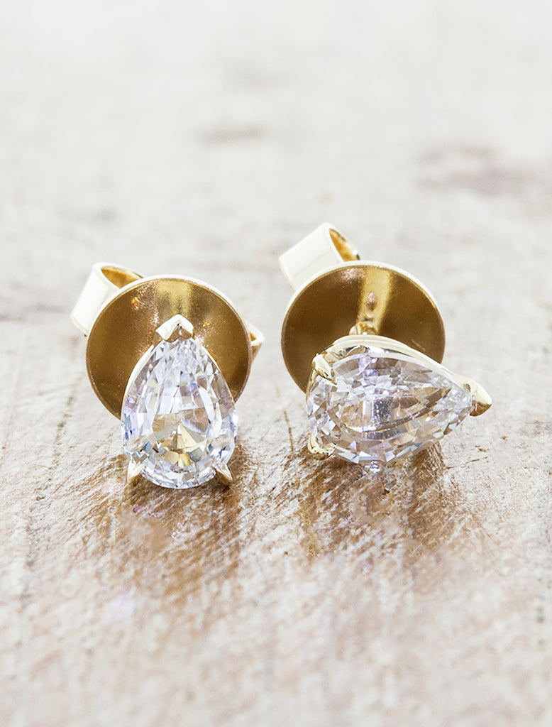 Pear Shaped diamond Stud Earrings. caption:Shown in 1ct total weight option, 14k yellow gold