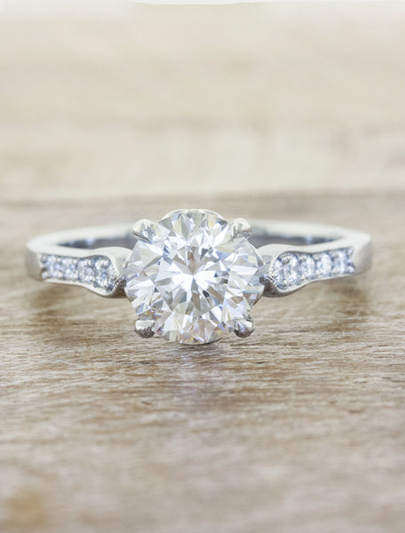 conflict free round diamond solitaire ring in an intricate band