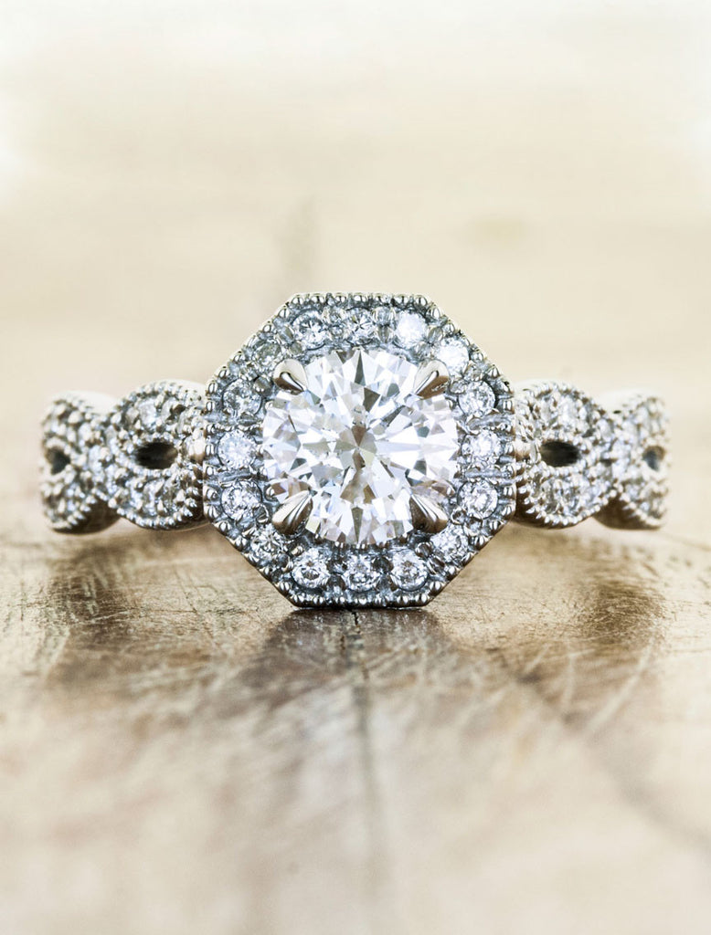 Vintage halo;caption:0.70ct. Round Diamond 14k White Gold