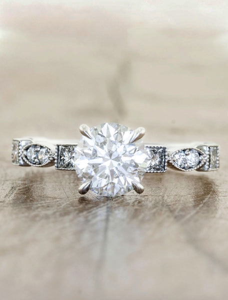 Vintage inspired designs;caption:0.90ct. Round Diamond Platinum