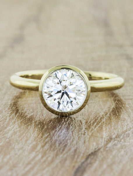 Solitaire bezel caption:1.15ct. Round Diamond 14k Yellow Gold