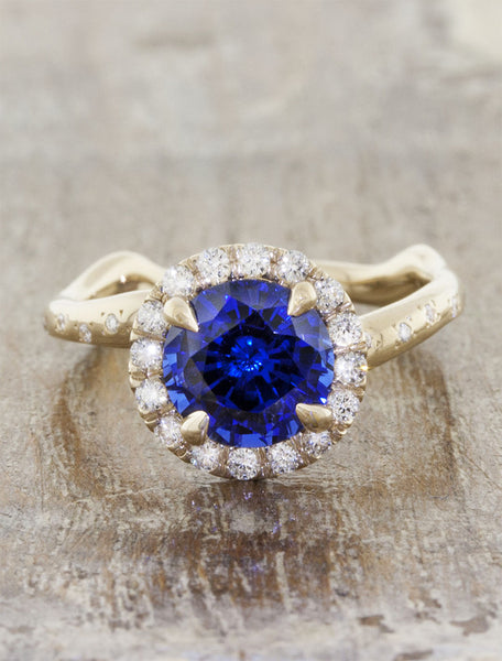 Nature inspired engagement ring halo;caption:1.85ct. Round Sapphire 14k Yellow Gold customized with diamonds in the band