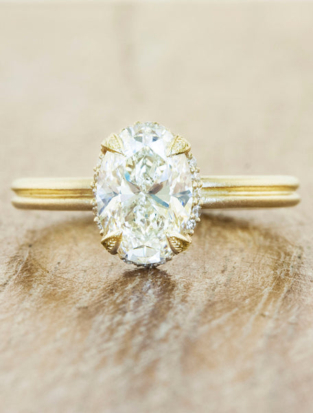 Nature inspired solitaire double band;caption:1.50ct. Oval Diamond 14k Yellow Gold