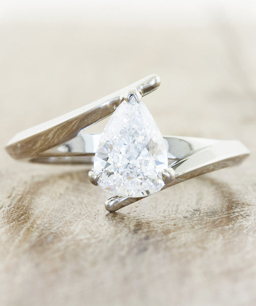 unique pear diamond ring, asymmetrical band. caption:Customized with an 1.25ct. Pear Diamond, Platinum