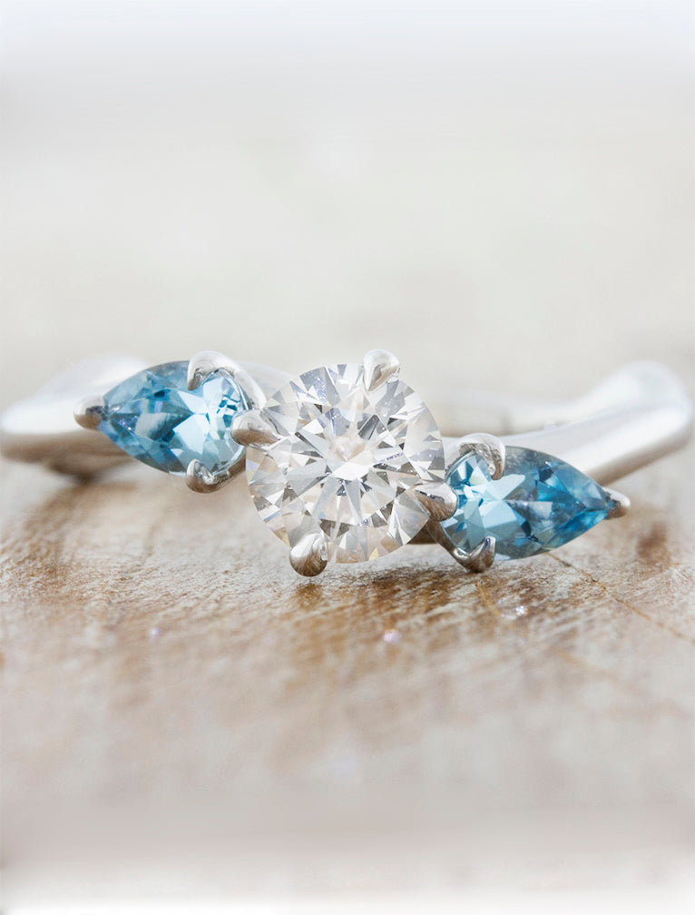 Nature inspired three stone setting;caption:0.75ct. Round Diamond and Aquamarine Platinum