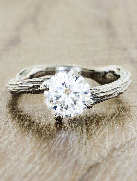 Nature inspired solitaire engagement ring caption:1.25ct. Round Diamond Platinum