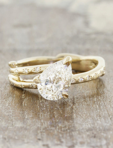 Nature inspired engagement ring leaf prongs;caption:1.10ct. Pear Diamond 14k Yellow Gold
