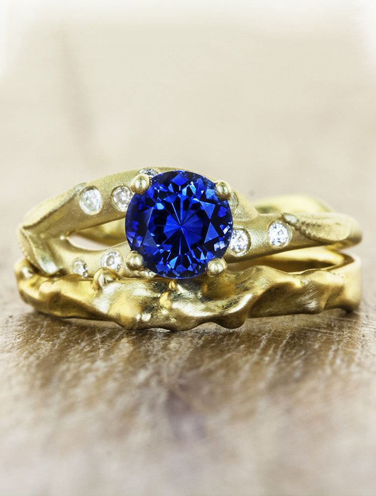 gold asymmetric band, round sapphire engagement ring