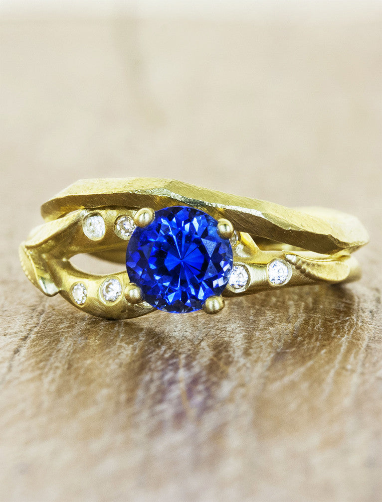 split shank asymmetric band sapphire engagement ring