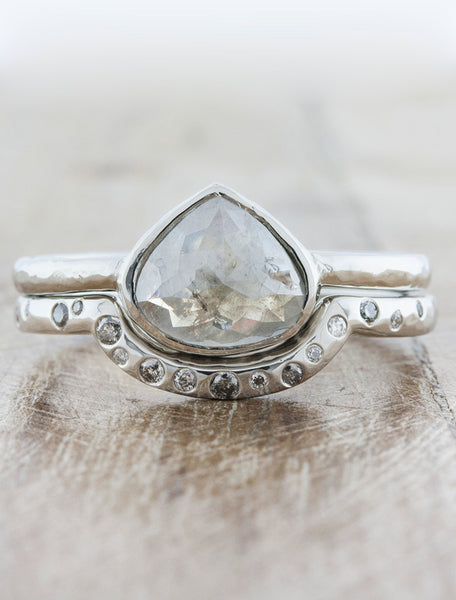 Modern bezel set engagement ring caption:2.30ct. Rustic Pear Diamond Platinum paired with Lula wedding band
