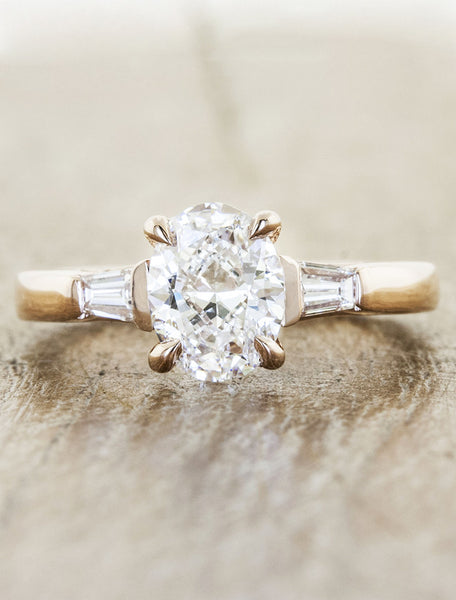 three stone diamond yellow gold ring, baguette accents;caption:Customized with an 1.30ct Oval Diamond, 14k Rose Gold