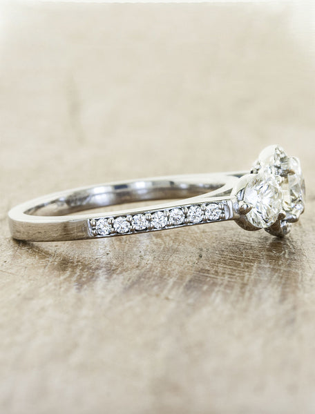 vintage-inspired three stone diamond ring, halo