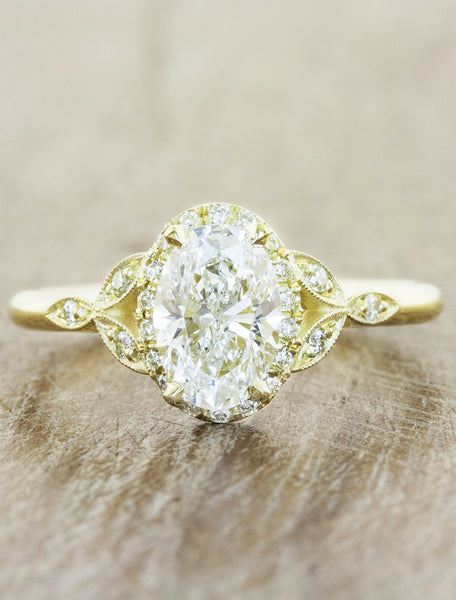 Vintage inspired halo engagement ring;caption:1.00ct. Oval Diamond 18k Yellow Gold