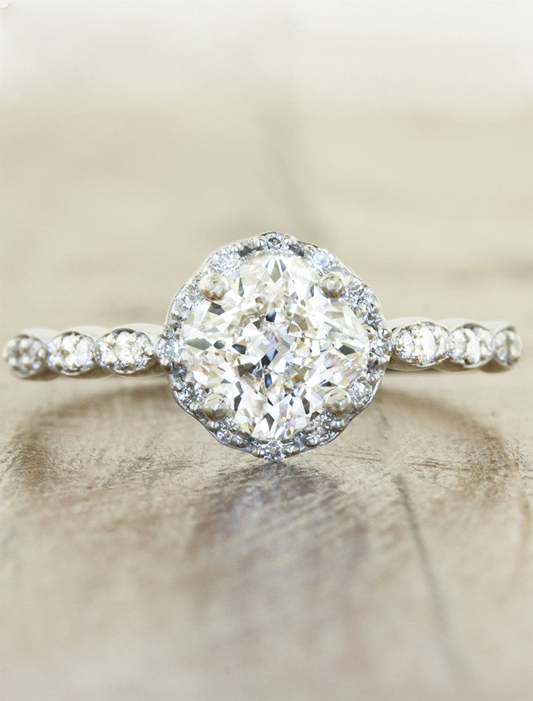 feminine cushion cut diamond ring;caption:1.30ct. Cushion Cut Diamond Platinum