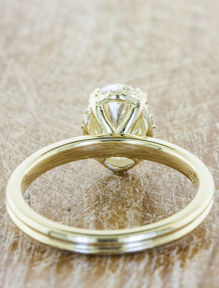 sleek modern gold band, oval diamond 4 prong engagement ring