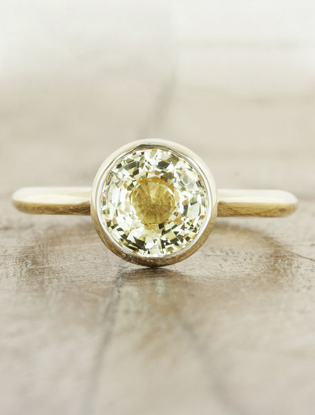 caption:Customized with a yellow sapphire