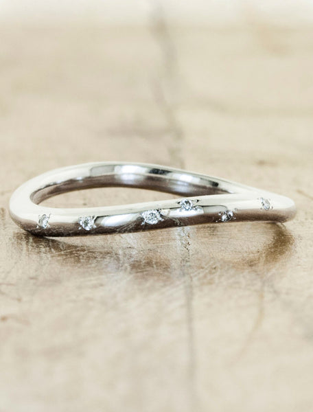delicate curved diamond wedding band