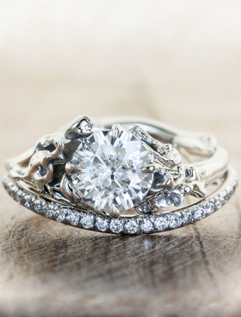 flower inspired diamond engagement ringcaption:1.00ct. Round Diamond Platinum paired with Bella wedding band