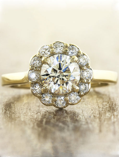 caption:Customized with a round diamond center stone