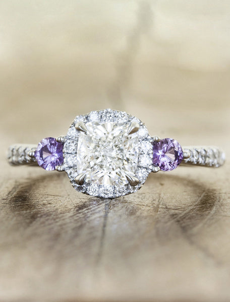 halo cushion cut diamond engagement ring with purple sapphire accents