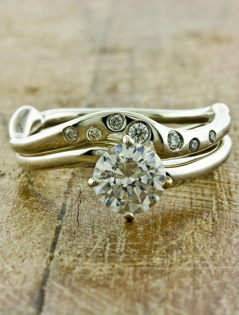 Handmade Organic Wedding Bands by Ken & Dana Design - Sati & Aurora pairing. caption:Shown with Aurora engagement ring