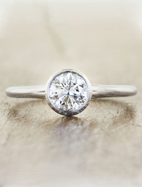 clean bezel set diamond engagement ring