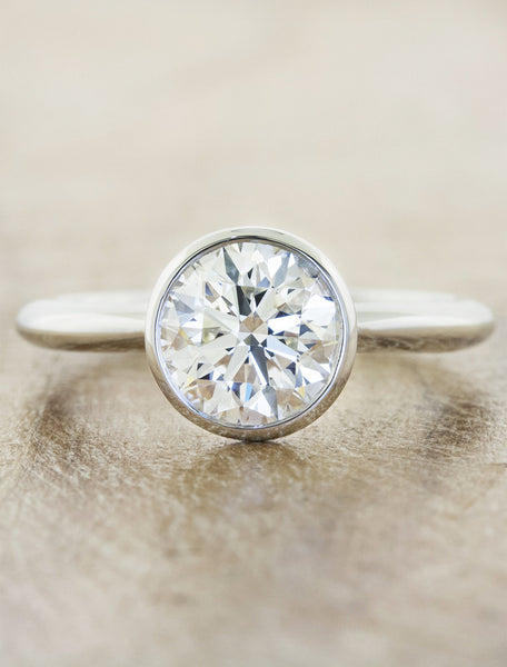 Solitaire bezel caption:1.50ct. Round Diamond Platinum