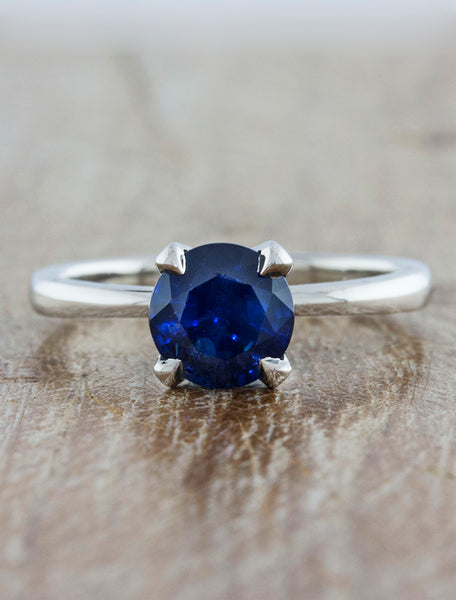 Engagement ring tapered band;caption:1.50ct. Round Sapphire Platinum