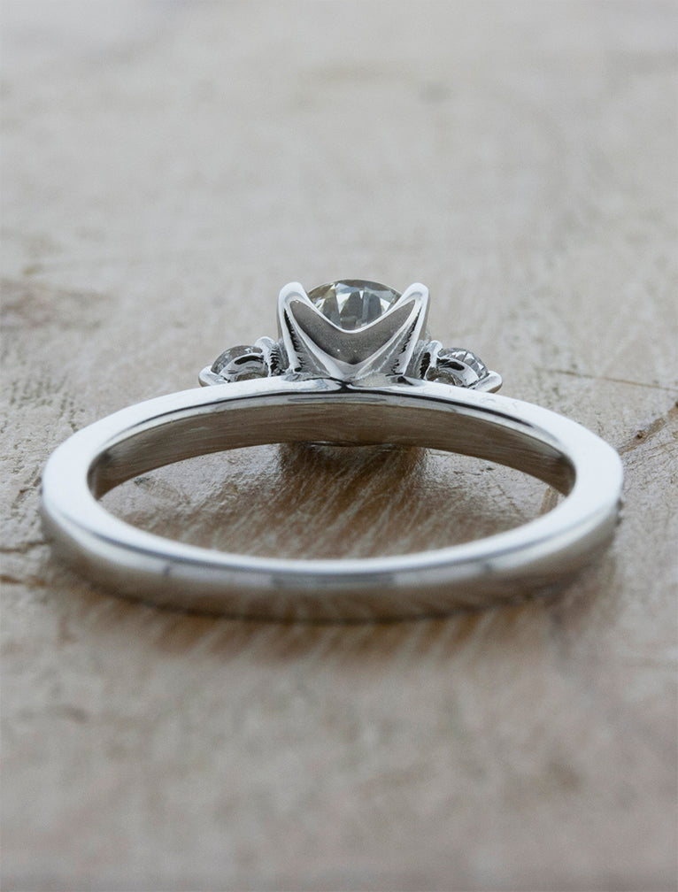 Three Stone Round Cut Diamond Ring with Intricate Basket