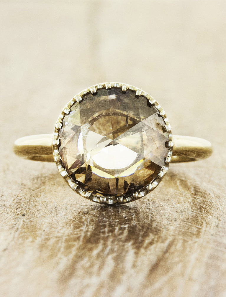 Rose cut cognac diamond in a bezel yellow gold setting