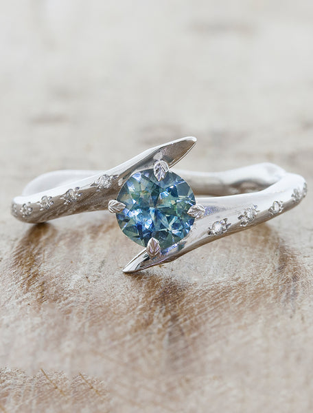 unique asymmetrical engagement ring;caption:0.70ct. Round Sapphire 14k White Gold