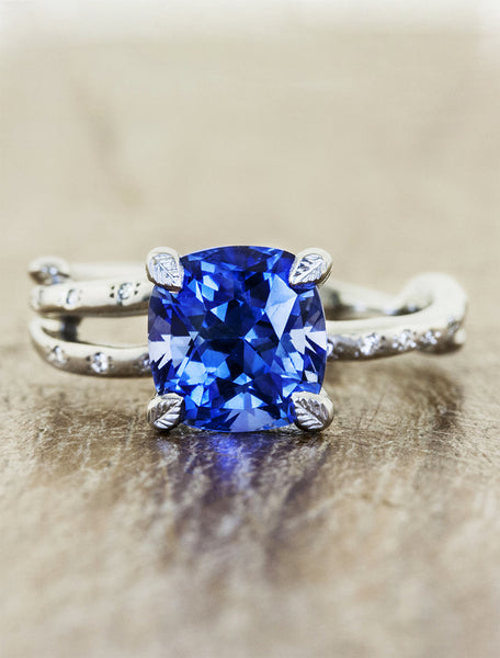 Nature inspired engagement ring leaf prongs;caption:1.75ct. Cushion Cut Sapphire 18k White Gold