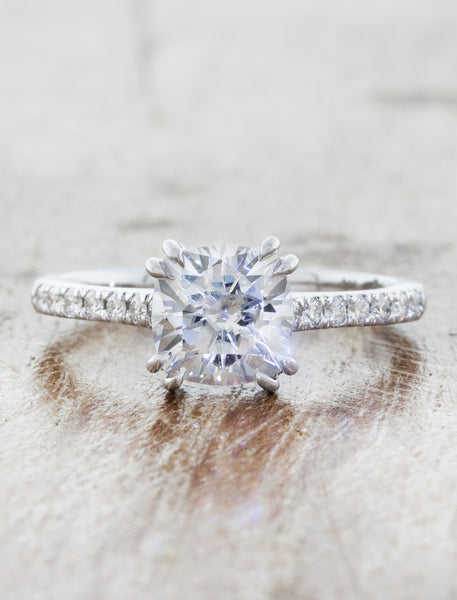 Solitaire with pave diamond band double prongs;caption: 1.25ct. Cushion Cut Diamond 14k White Gold