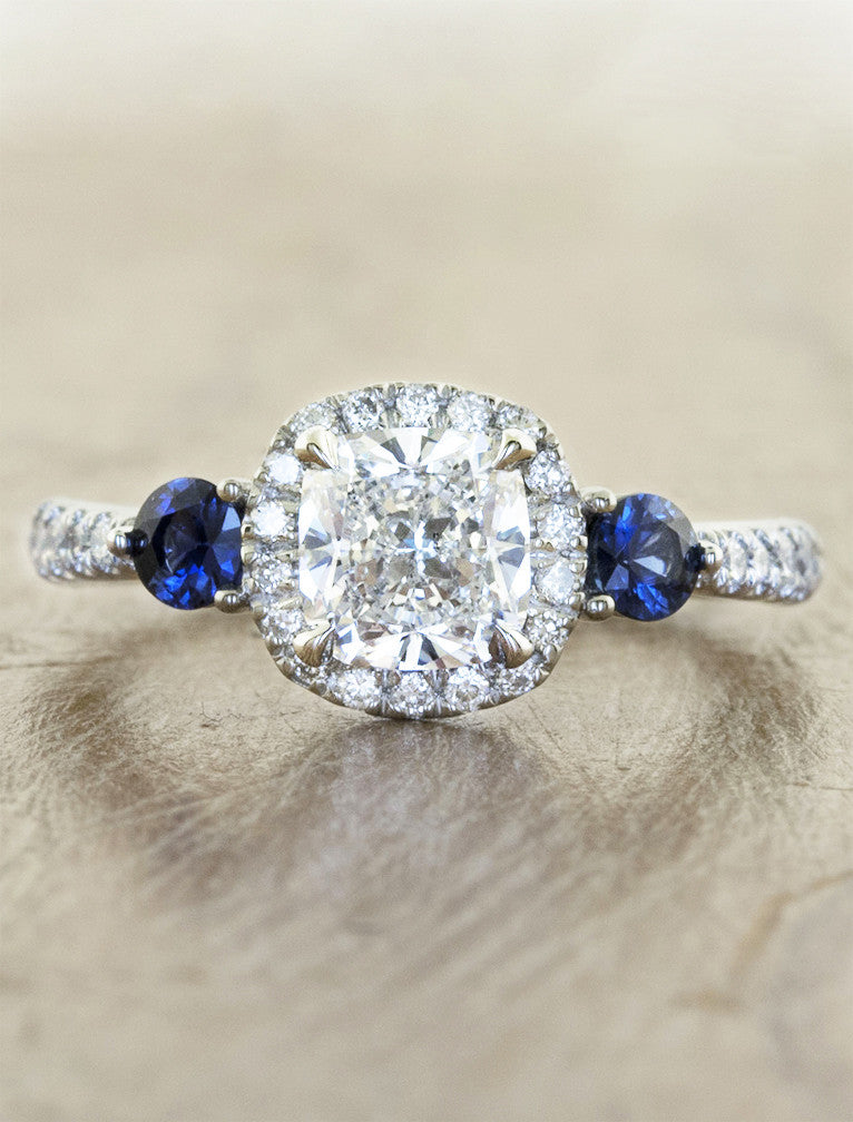halo cushion cut diamond engagement ring with blue sapphire accents