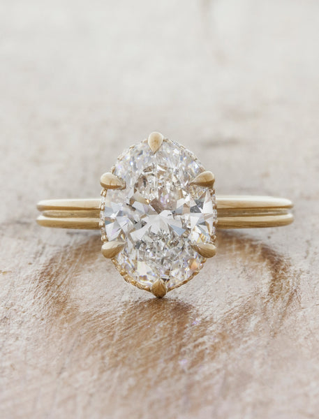 Nature inspired solitaire double band;caption:2.25ct. Oval Diamond 14k Yellow Gold