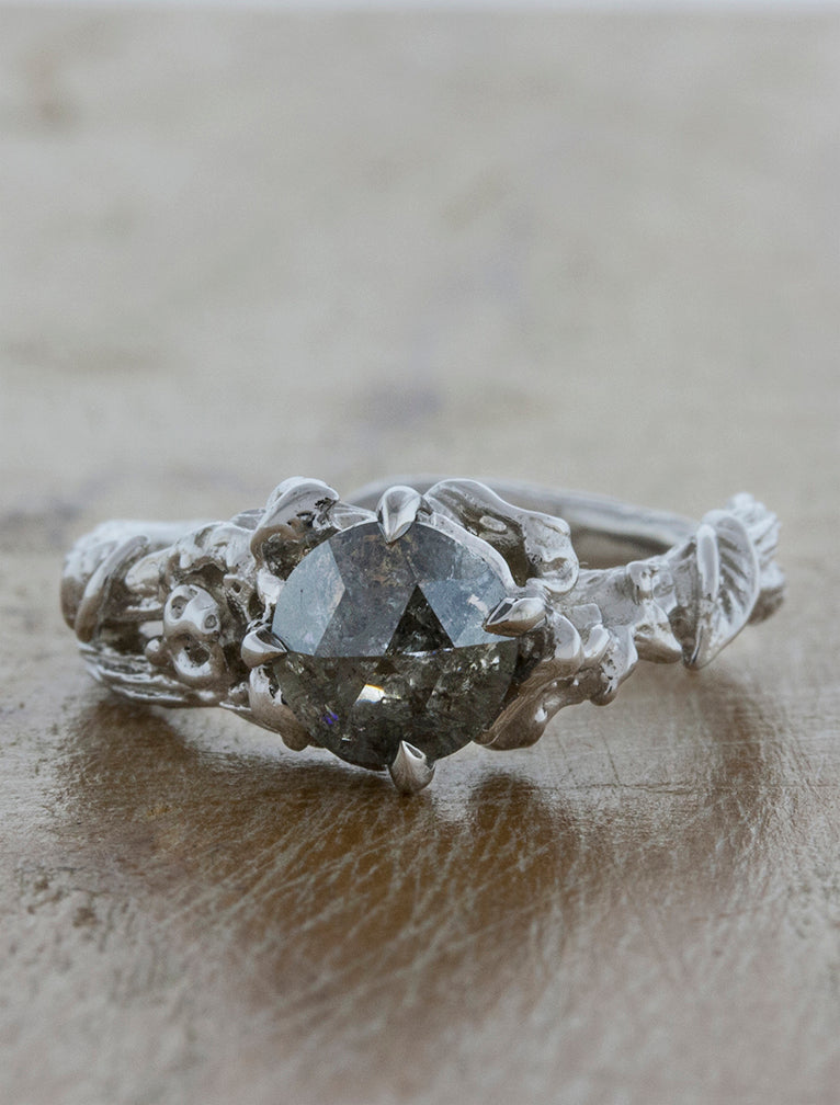rough grey diamond, set in a leafy, organic band engagement ring