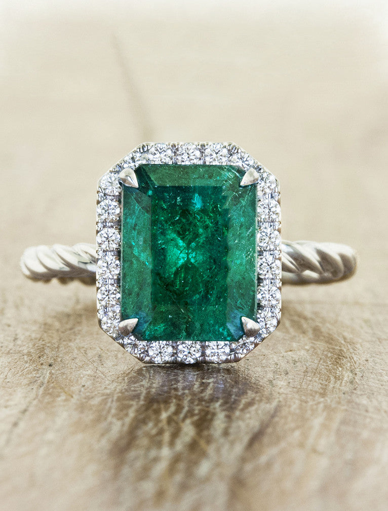 emerald engagement ring, twisted band caption:emerald engagement ring, twisted band
