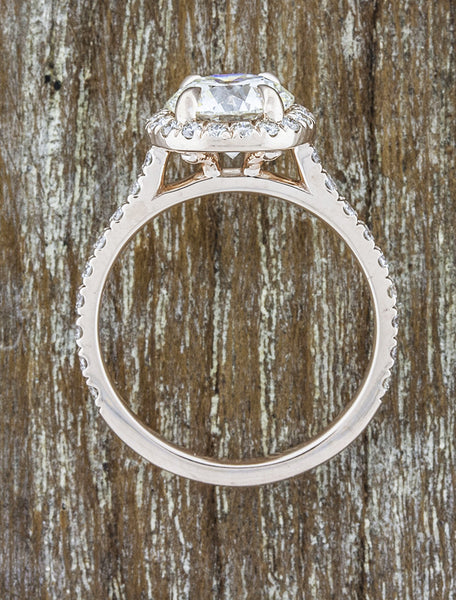 halo round diamond engagement ring in rose gold band