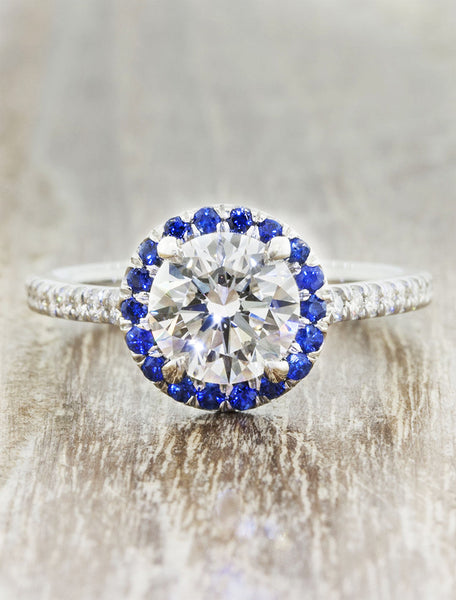 Round halo engagement ring. caption:Customized with a sapphire halo