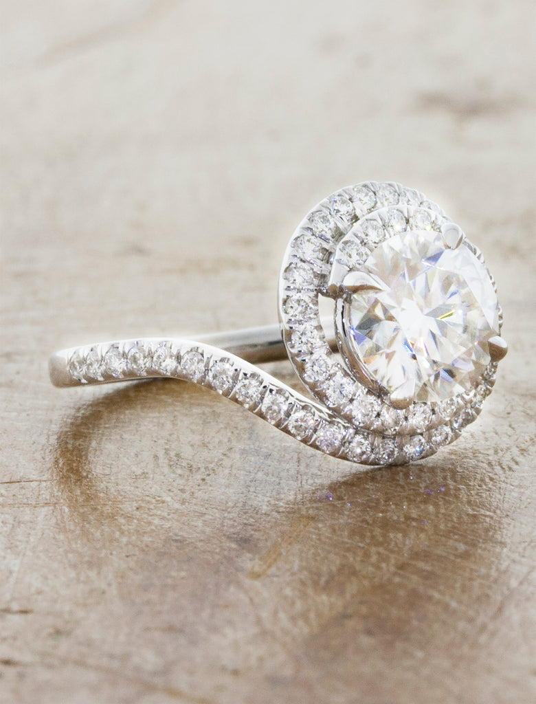 assymetrical swirling halo diamond engagement ring