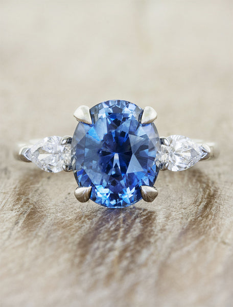 caption:Shown here with a blue sapphire center stone