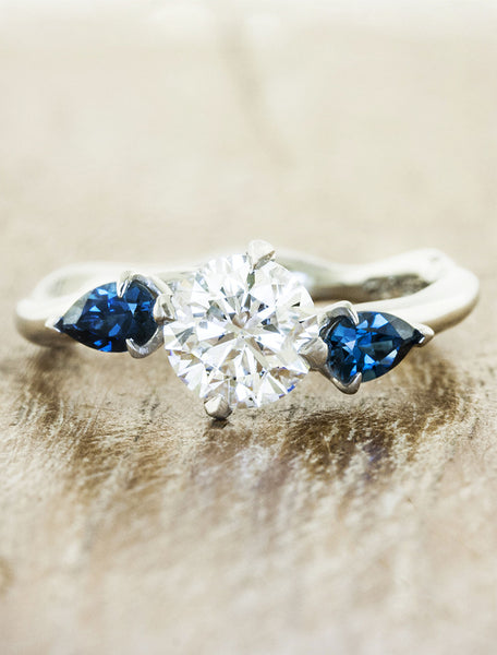Nature inspired three stone setting;caption:1.25ct. Round Diamond and Blue Topaz 14k White Gold