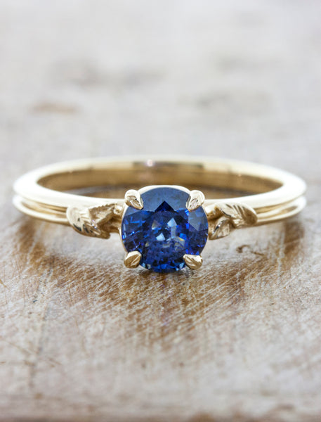 round blue sapphire engagement ring in double band