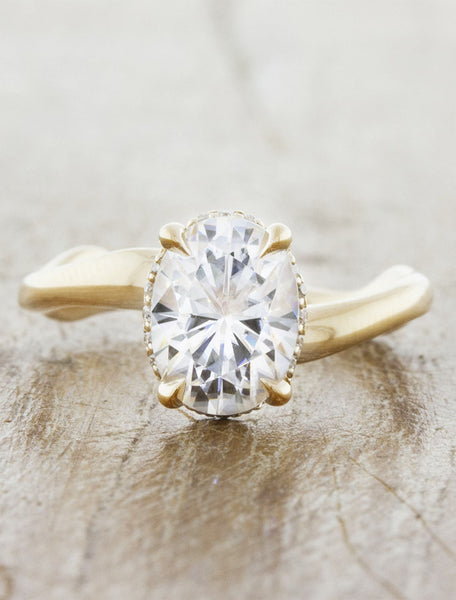 Nature inspired engagement ring hidden halo;caption:1.50ct. Oval Diamond 14k Yellow Gold