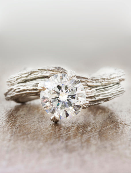 Nature inspired solitaire engagement ring caption:1.20ct. Round Diamond Platinum paired with Autumn wedding band