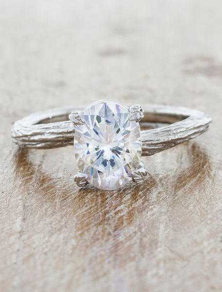 Nature inspired solitaire engagement ring caption:1.40ct. Oval Diamond 18k White Gold