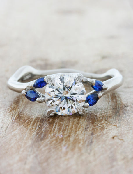 caption:Customized with blue sapphire accents