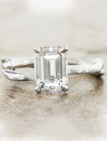 unique split shank emerald cut diamond engagement ring with diamond accents