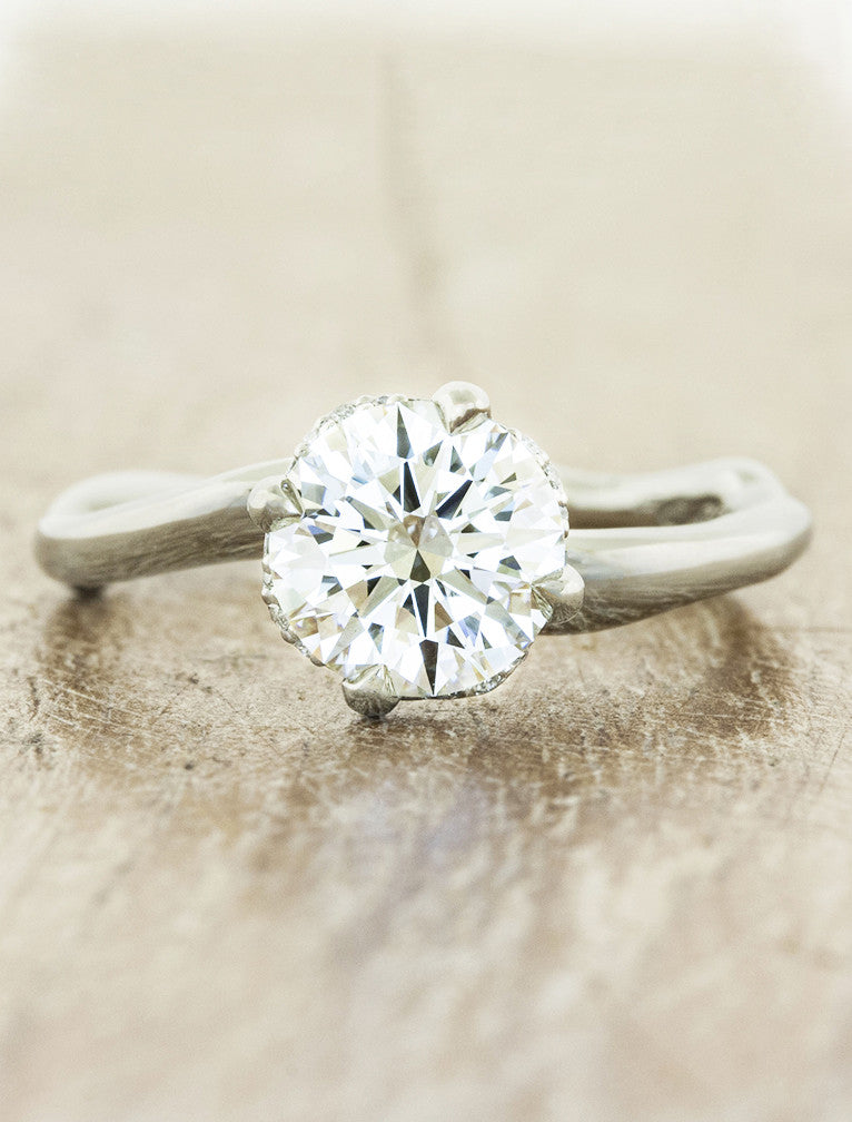 organic shaped band diamond solitaire engagement ring;caption:1.25ct. Round Diamond Platinum