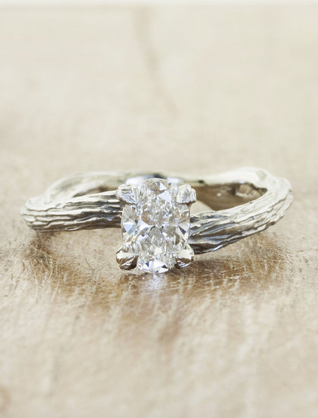 Nature inspired solitaire engagement ring caption:0.90ct. Oval Diamond Platinum